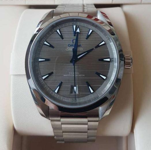 The blue hands and hour markers are striking on the gray dial.